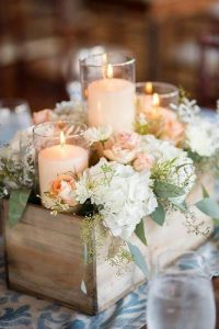 rustic-wedding-décor-wooden-crate-centerpiece-with-flowers-and-candles-maypolestudios-via-instagram-334x500